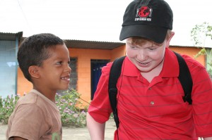 A meal recipient in Nicaragua shares his music with Davis on a recent Vision Trip with Stop Hunger Now.