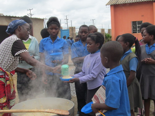 ACE Zambia Students receiving food 01-2014