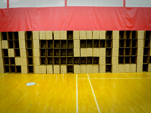 Empty boxes to be filled are arranged along the wall to spell 'NCSU!'